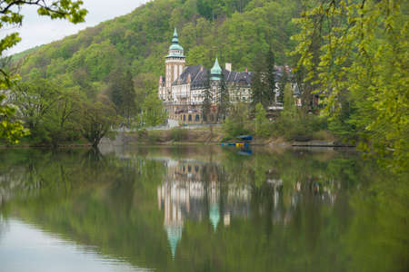 Lillafured palace northern front (Miskolc, Hungary). Lake Hamori in foreground, mountains covered with multicolored forest - background.