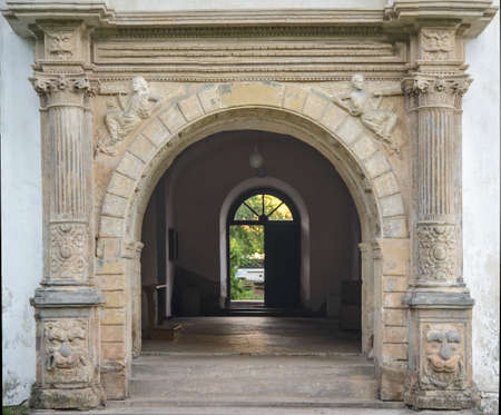 Arched passage to the park of Yazlovets monastery. Ternopil region.