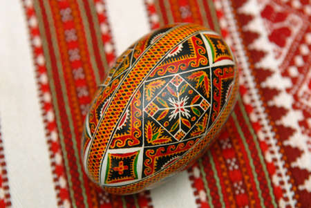 Easter egg (Pysanka) on embroidered canvas. Kolomyia.