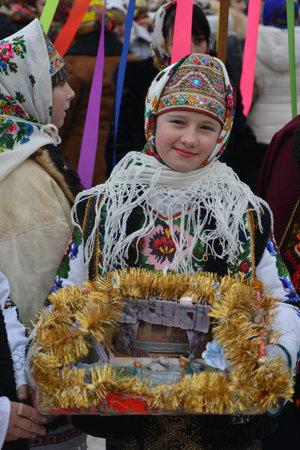 Vashkivtsi, Chernivtsi Oblast, Ukraine - 14.01.2013: Malanka celebration. Girl in a festive Ukrainian costume. Festivities. Vashkivtsi.