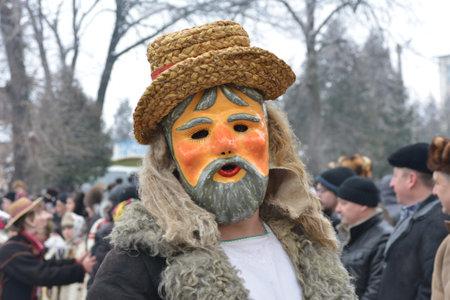 Vashkivtsi, Chernivtsi Oblast, Ukraine - 14.01.2013: Malanka celebration. Man in a festive costume and mask. Festivities. Vashkivtsi.