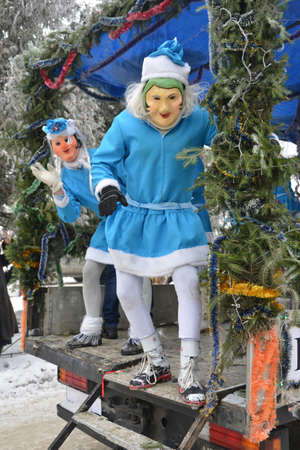 Vashkivtsi, Chernivtsi Oblast, Ukraine - 14.01.2013: Malanka celebration. Men dressed as snow maiden. Editorial