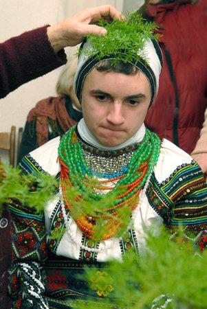 Goroshova, Ternopil Oblast, Ukraine - 14.01.2013: Young man is dressed up in Malanka costume. Malanka celebration in Goroshova village.