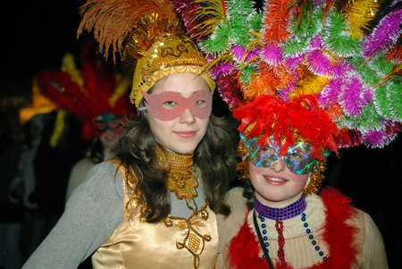Goroshova, Chernivtsi Oblast, Ukraine - 14.01.2013: Masked girls at Malanka carnival, night time. Editorial