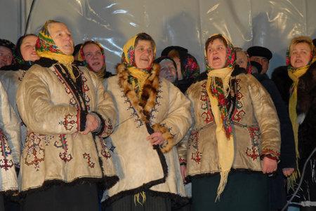 Goroshova, Ternopil Oblast, Ukraine - 14.01.2013: Aged women in Ukrainian costumes sing at the Malanka celebration.