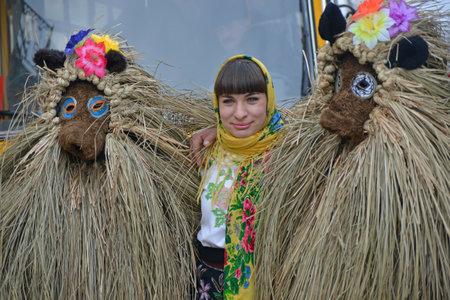 Chernivtsi, Chernivtsi Oblast, Ukraine - 15.01.2013 : Malanka parade in Chernivtsi. Characters in straw suit.