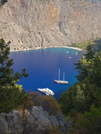 Butterfly Valley over view. White yachts sail in blue sea.