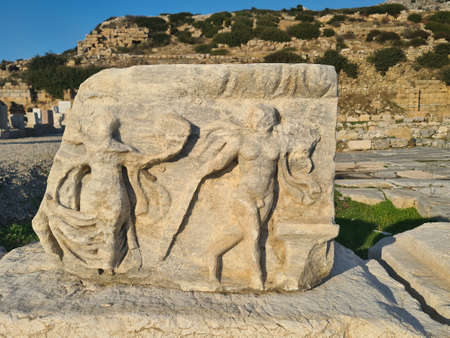 Human figures is carved into stone All this is in ancient Knidos. Stock Photo