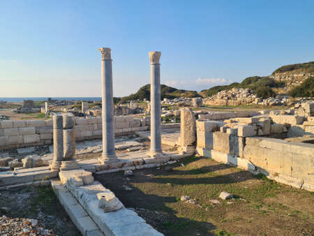 Marble columns in ancient Knidos city. Blue sky in background.