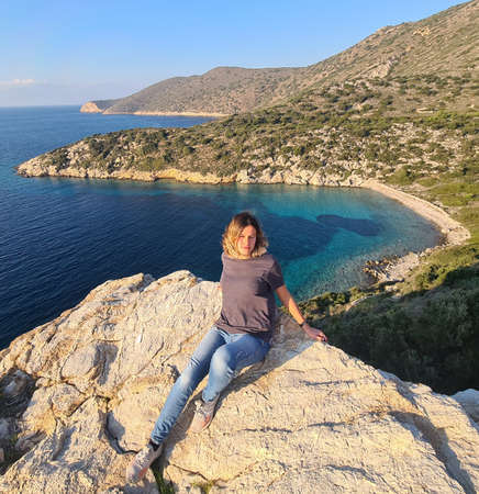 Girl against seascape on Datca Peninsula. Good vacations. Stock Photo