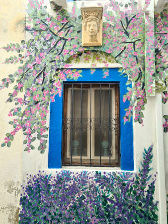 Window in beautiful colorful frame. Bodrum beatiful streets.