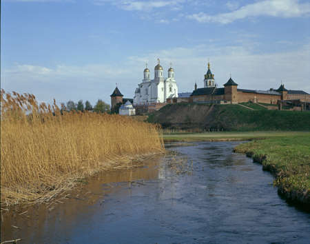 Zymne Monastery general view. Blue river in foreground. Another name: Assumption Monastery at the Holy Mountain. Stock Photo