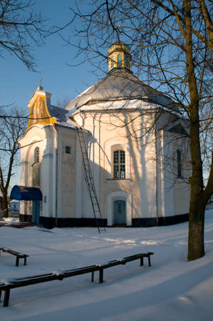 Candlemas (Candlemass) church in Olyka. Snow in foreground. Blue sky in background.