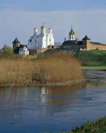 Zymne Monastery (Assumption Monastery at the Holy Mountain). Monastery is reflected in water. Stock Photo