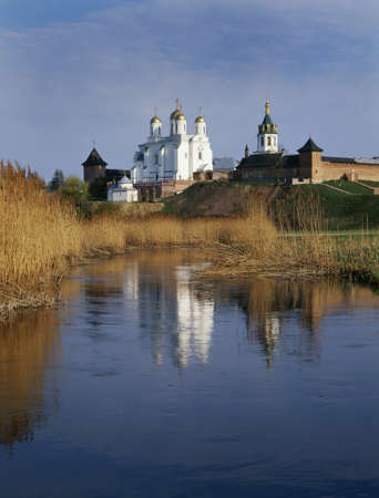 Zymne Monastery over the river. Another name: Assumption Monastery at the Holy Mountain. Stock Photo