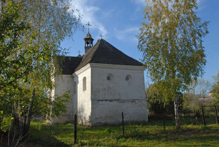 Chapel of Peter and Paul in Olyka. Blue sky in background. Autumn birches enliven the composition. Stock Photo