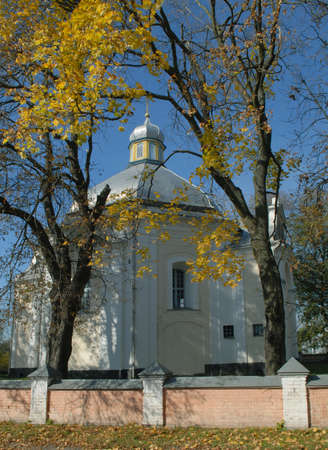 Candlemas (Candlemass, Sretenskaya) church among yellow leaves. Olyka landmarks.