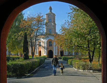 Radziwills residence in Olyka. View through gate. Bluw sky in background. Stock Photo