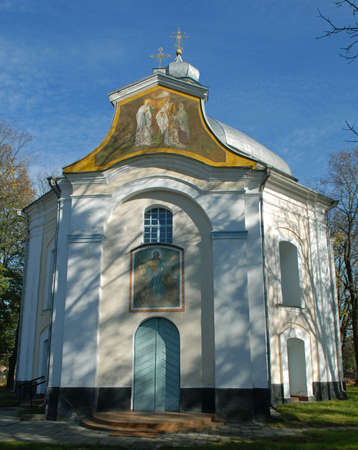 Facade of Candlemas (Candlemass) church against blue sky. Two paintings (frescoes) are visivle.