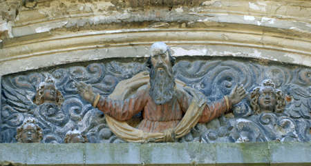 Saint sculpture on catholic cathedralh facade. Colleagues cathedral decoration. Olyka.