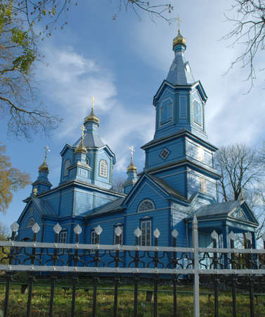 Church of Blessed Virgin Nativity oin Olyka. Blue sky, yellow leaves. Stock Photo