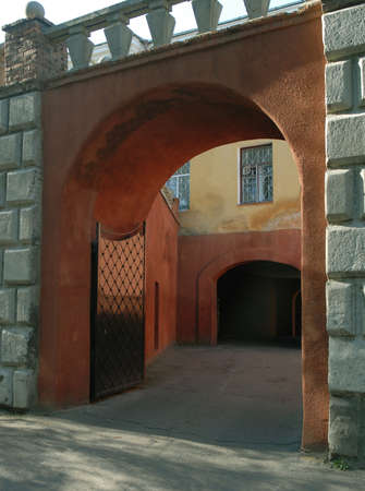 Entrance to medieval Radziwills castle in Olyka. The gate is open.