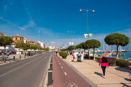 catalunya: CAMBRILS, SPAIN - APRIL 30, 2017: Seaside promenade. Copy space. Space for text