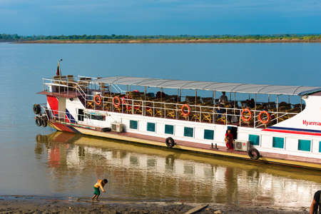 BAGAN, MIANMAR - DECEMBER 1, 2016: Tourist boat on the bank of the river Irrawaddy, Burma. Copy space for text