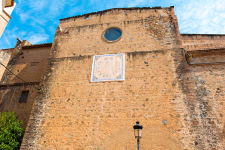 MONTBRIO DEL CAMP, SPAIN - JUNE 6, 2016: Old sundial on a building wall in Montbrio del Camp, Tarragona, Catalunya, Spain