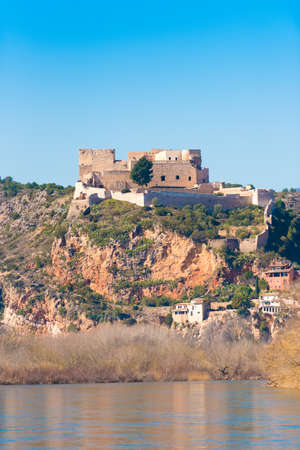 Views of the castle of Miravet, Tarragona, Catalunya, Spain. Vertical. Space for text. Copy space