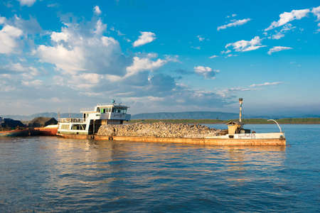 BAGAN, MIANMAR - DECEMBER 1, 2016: Cargo barge on the Irrawaddy River in Bagan, Myanmar