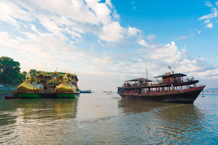 BAGAN, MIANMAR - DECEMBER 1, 2016: Tourist boat on the Irrawaddy River in Bagan, Myanmar Editorial