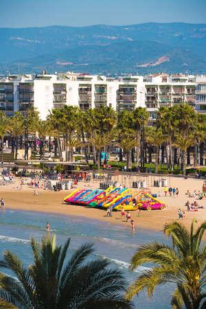 the dorada: SALOU, TARRAGONA, SPAIN -  APRIL 24, 2017: Water attractions on the Costa Dorada beach. Vertical