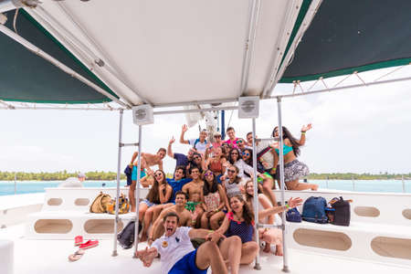 SAONA, DOMINICAN REPUBLIC - MAY 25, 2017: Group of tourists on a yacht. Copy space for text Publikacyjne