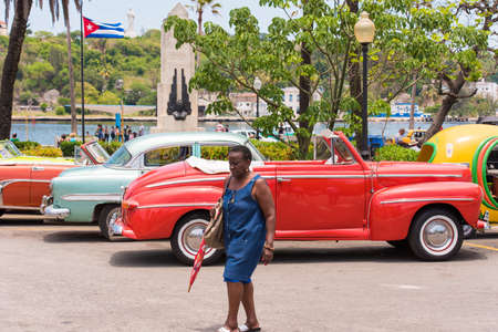 CUBA, HAVANA - MAY 5, 2017: American multicolored retro cars in the parking lot. Copy space for text Editorial