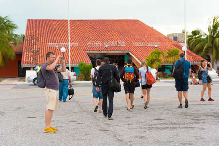 CAYO LARGO, CUBA - MAY 10, 2017: Tourists at the airport. Copy space for text