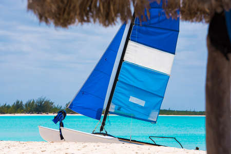 Sailboat on the sandy beach of the Playa Paradise of the island of Cayo Largo, Cuba. Copy space for text