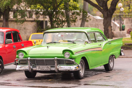 CUBA, HAVANA - MAY 5, 2017: Green American retro car on a city street. Copy space for text