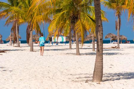 Women go to Playa Sirena beach, Cayo Largo, Cuba