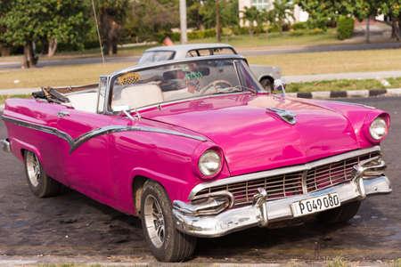 CUBA, HAVANA - MAY 5, 2017: American pink retro cabriolet on city street. Close-up Editorial