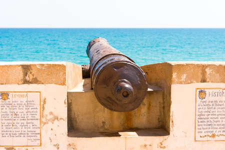 Ancient tools on the fortress wall. Fortress cannon in Sitges, Barcelona, Catalunya, Spain. Copy space for text Editorial