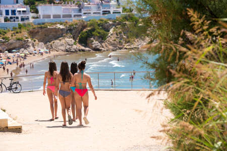 Four girls in bathing suits go to the beach in Sitges, Barcelona, Catalunya, Spain Editorial