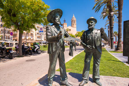 SITGES, CATALUNYA, SPAIN - JUNE 20, 2017: Sculptures of artists on the waterfront