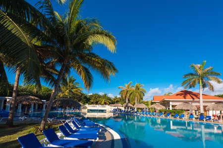 varadero: VARADERO, MATANZAS, CUBA - MAY 18, 2017: View of the swimming pool on site. Copy space for text