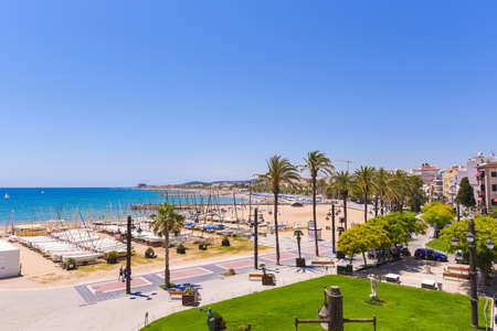 SITGES, CATALUNYA, SPAIN - JUNE 20, 2017: View over the promenade and the beach. Copy space for text