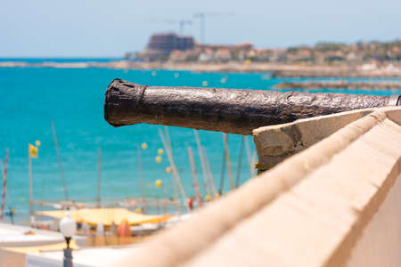 Ancient tools on the fortress wall. Fortress cannon in Sitges, Barcelona, Catalunya, Spain