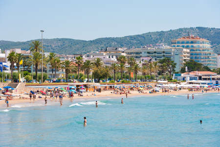 SITGES, CATALUNYA, SPAIN - JUNE 20, 2017: View of the sandy beach and promenade. Copy space for text