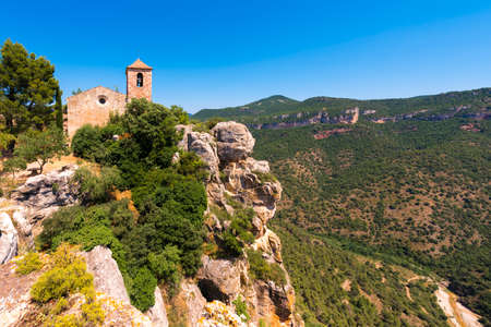 View of the Romanesque church of Santa Maria de Siurana, in Siurana de Prades, Tarragona, Catalunya, Spain. Copy space for text