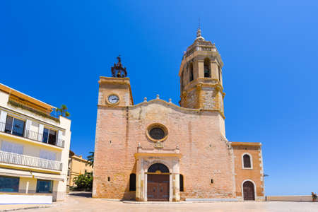 SITGES, CATALUNYA, SPAIN - JUNE 20, 2017: View of the church of of Sant Bartomeu and Santa Tecla. Copy space for text