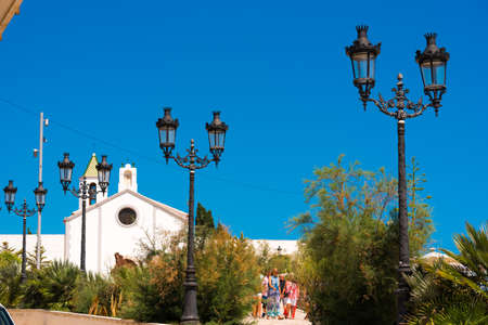 SITGES, CATALUNYA, SPAIN - JUNE 20, 2017: View of the Church of Ermita de Sant Sebastia. Copy space for text. Isolated on blue background Editorial